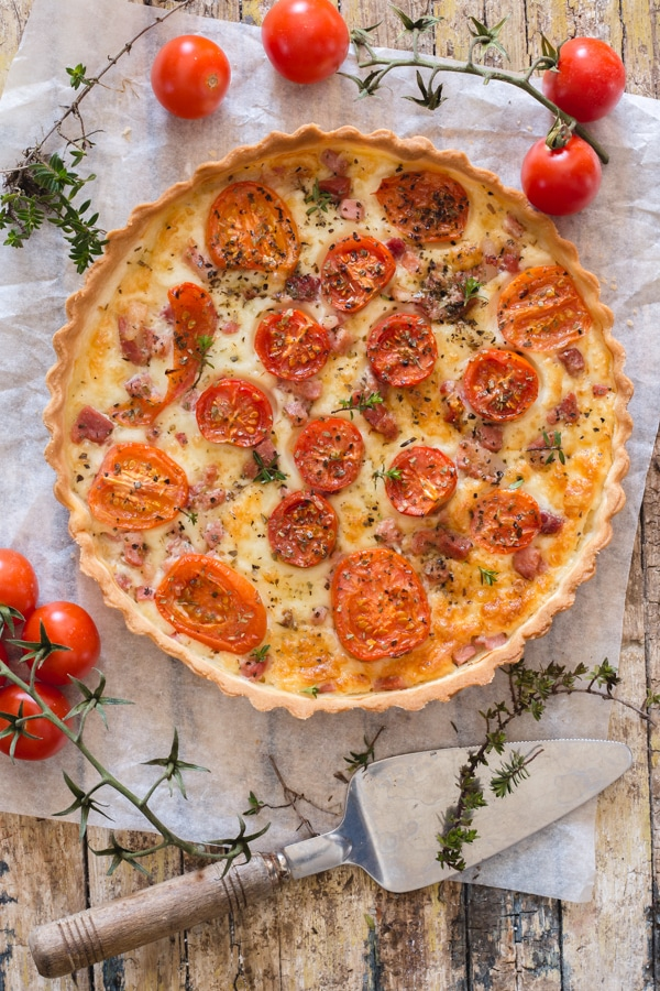 baked tomato savory pie on a board