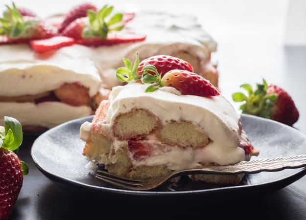 Strawberry Tiramisu,the perfect summer dessert, made with fresh strawberries, creamy mascarpone, and ladyfingers. fresh strawberries and cream.