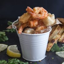fried seafood in a white bucket