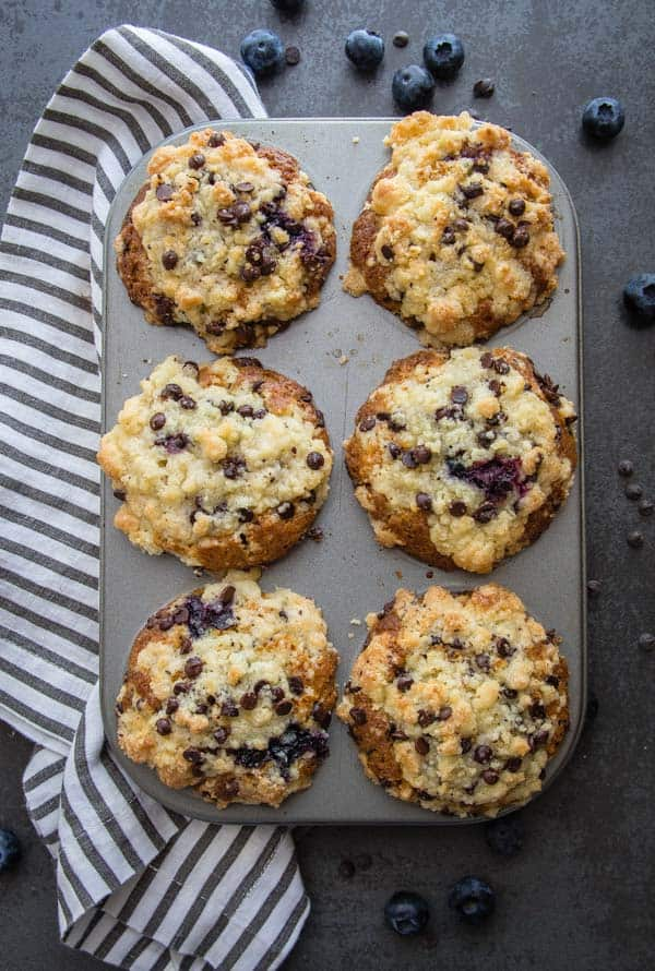 Streusel Topped Blueberry Chocolate Chip Muffins, these fast, easy and delicious muffins are the perfect snack, breakfast treat or dessert.