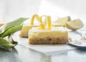 lemon cheesecake squares on a board