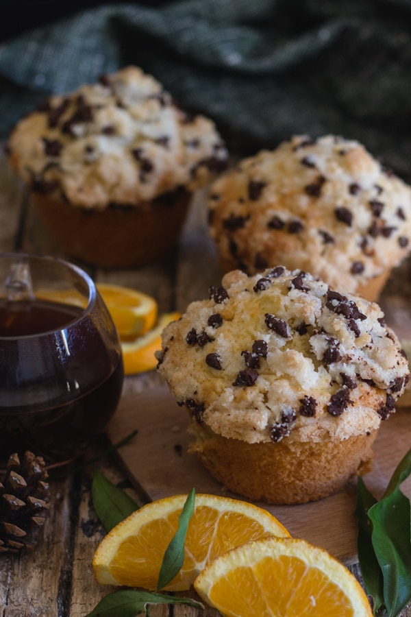 3 orange muffins on a wooden board