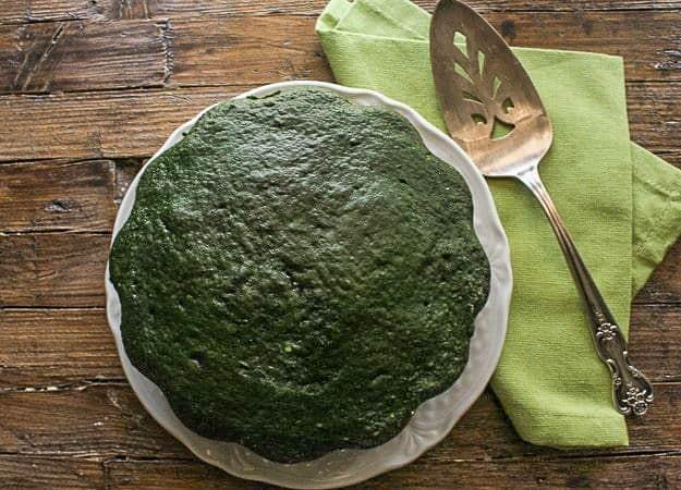 baked green velvet cake on a white dish