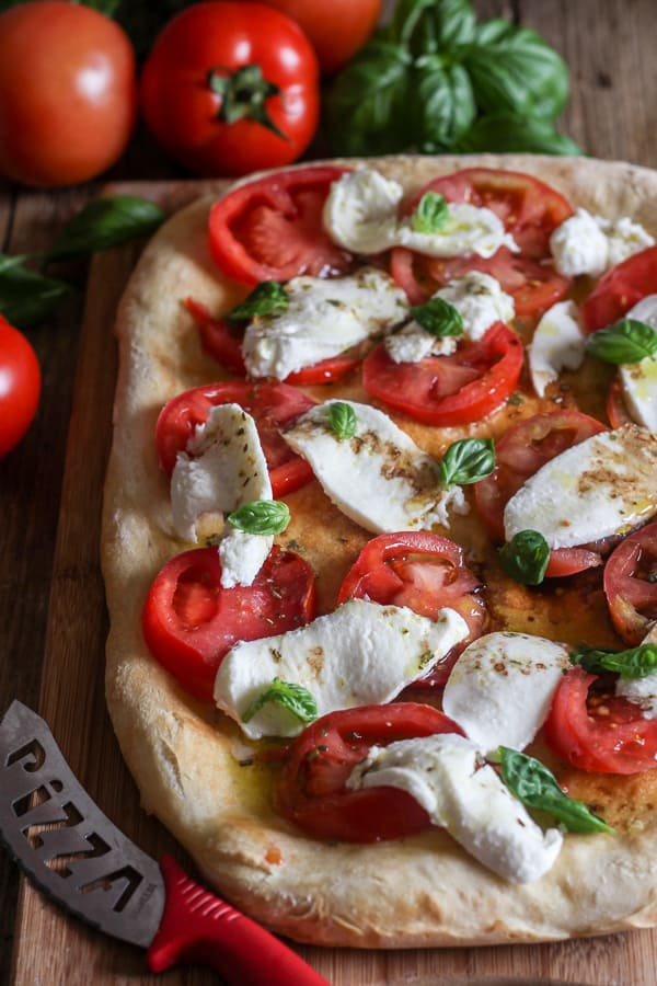 no yeast pizza dough caprese on a board