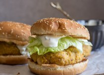 salmon burger with lettuce and yogurt dill sauce