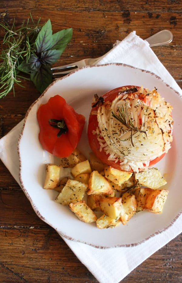 Italian Baked Stuffed Tomatoes with Rice, a healthy vegan/vegetarian dish. The perfect baked dinner recipe, with a delicious rice stuffing/anitalianinmykitchen.com