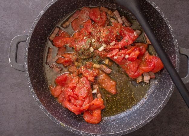 fresh tomatoes, pancetta and olive oil in a pan