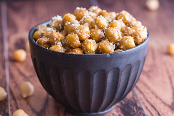 roasted chickpeas in a black bowl
