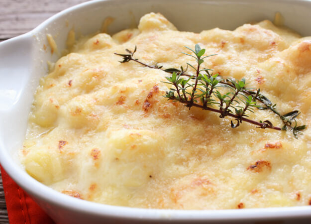 Baked Creamy Cheesy White sauce gnocchi in a white pan