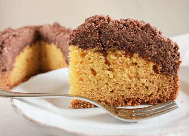 Vanilla Chocolate Crumb Cake, an easy New York style crumb cake recipe, a delicious double layer cake made with greek yogurt. A must try.