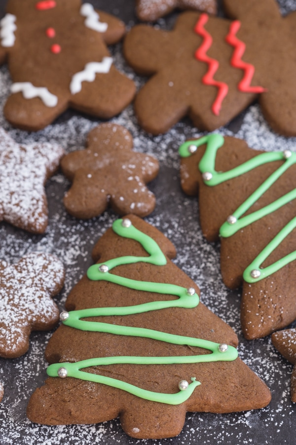 decorated gingerbread cookies on a black board
