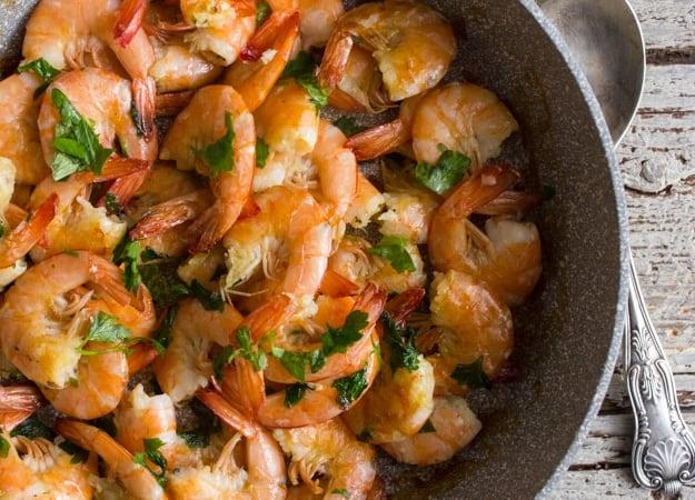 sauteed shrimp in a pan up close photo