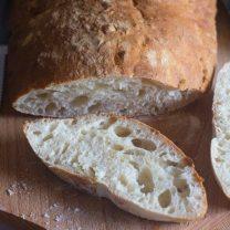 homemade italian ciabatta bread sliced on a wooden board