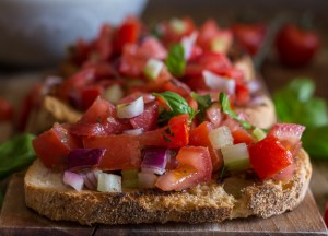 tomato bruschetta on toasted bread up close photo