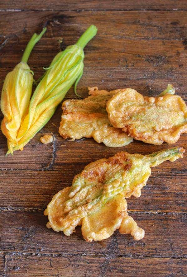 Italian Stuffed Zucchini Flowers, a delicious mozzarella cheese and prosciutto stuffed summer appetizer recipe. A must try!
