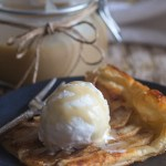 apple tart slice with vanilla ice cream and caramel sauce