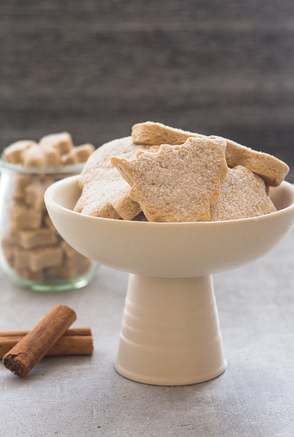 cinnamon sugar cookies on a plate and mini ones in a jar