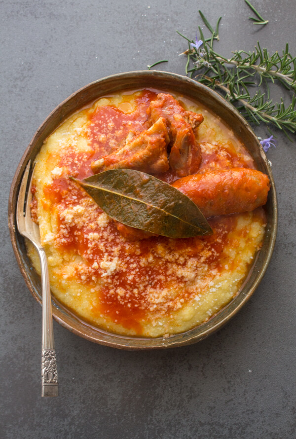 A creamy Traditional Polenta, served with a delicious Sausage Pork Rib Tomato Sauce Recipe, Italian Comfort Food at it's best.