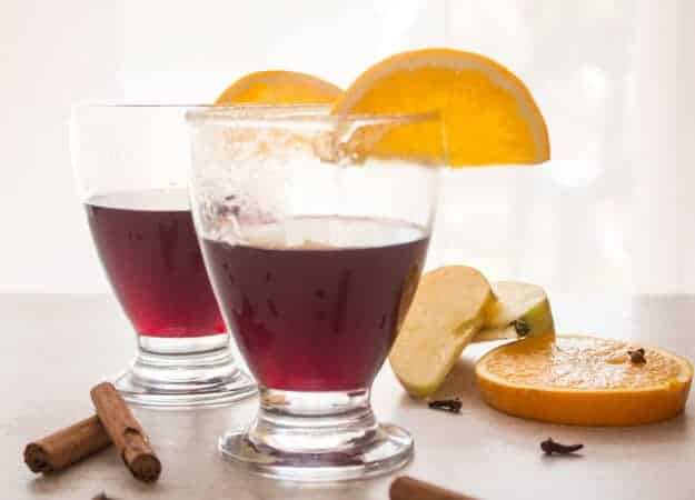 Easy Mulled Wine Recipe,red wine simmered with slices of orange, apple, cinnamon, cloves, fig and honey.A delicious simple feel better drink.