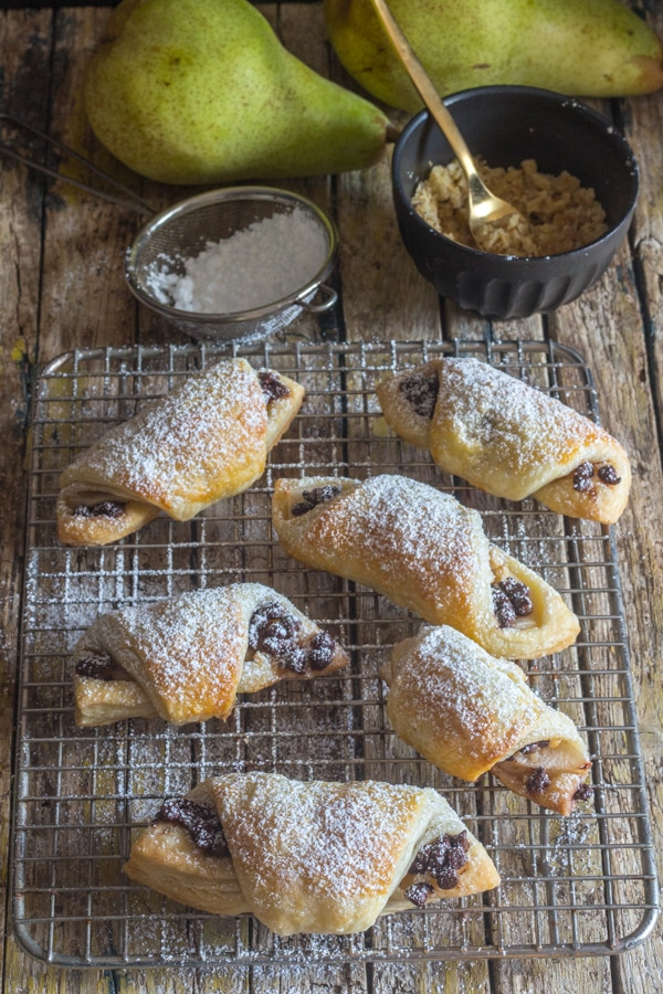 puff pastry crescents on a wire rack dusted with powdered sugar