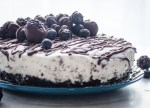 Light Cream Cheese Berry Cheesecake, a chocolate cookie crumb base and a creamy no bake chocolate chip filling. A delicious dessert recipe.