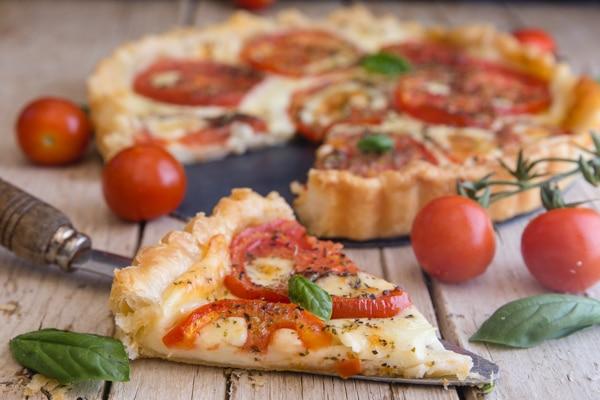 up close slice of tomato pie