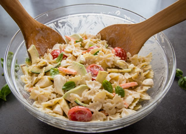 creamy italian pasta salad in a large glass bowl