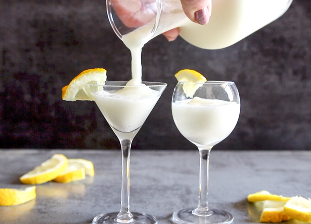 pouring lemon sorbet drink in a glass