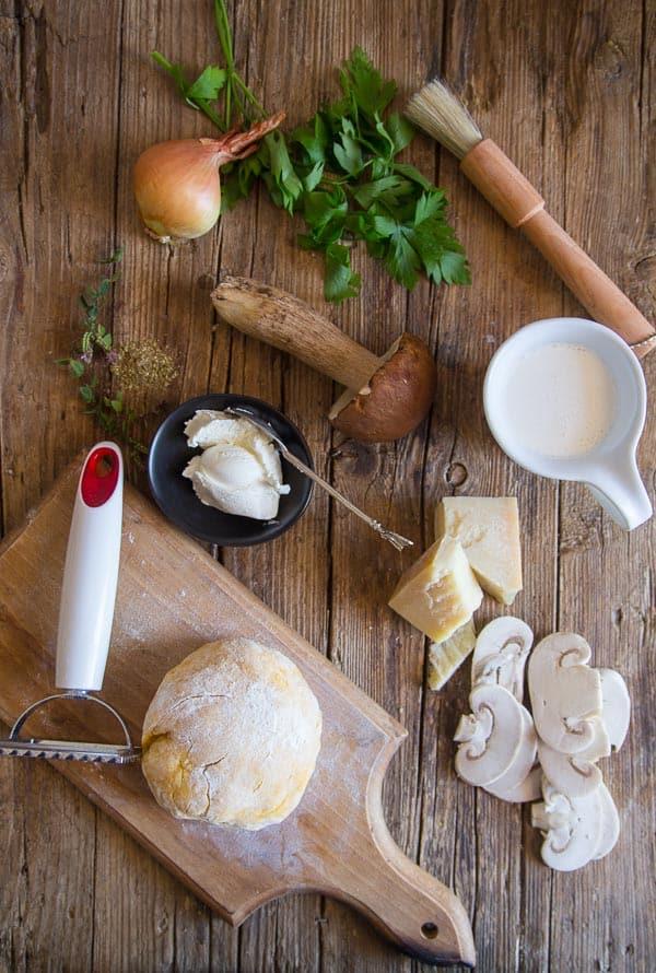 ingredients needed to make mushroom ravioli mushrooms, parmesan, parsley taken from above