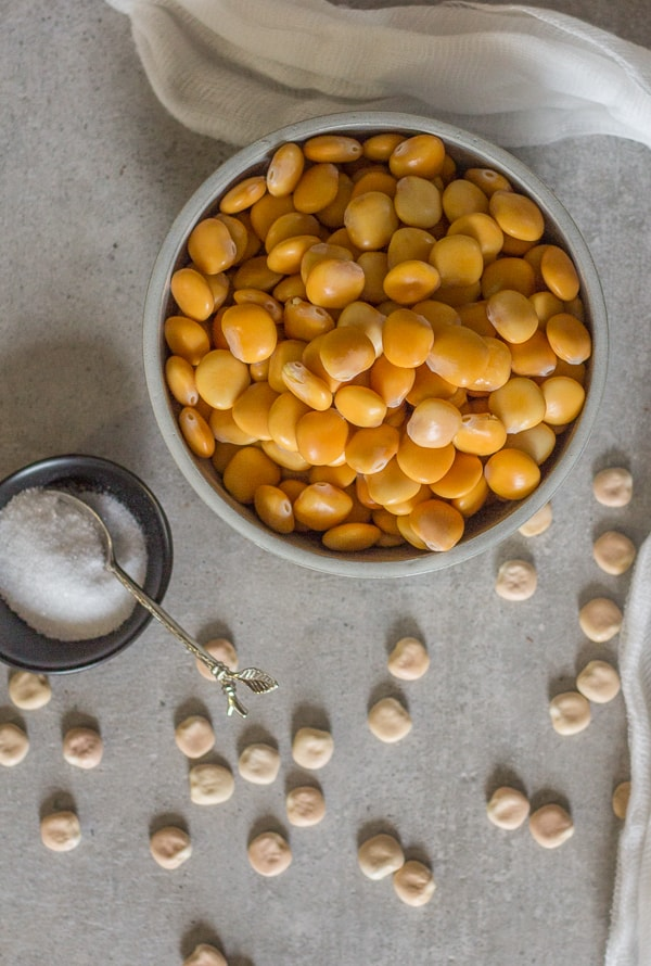top photo of lupin beans in a bowl with dry ones beside it