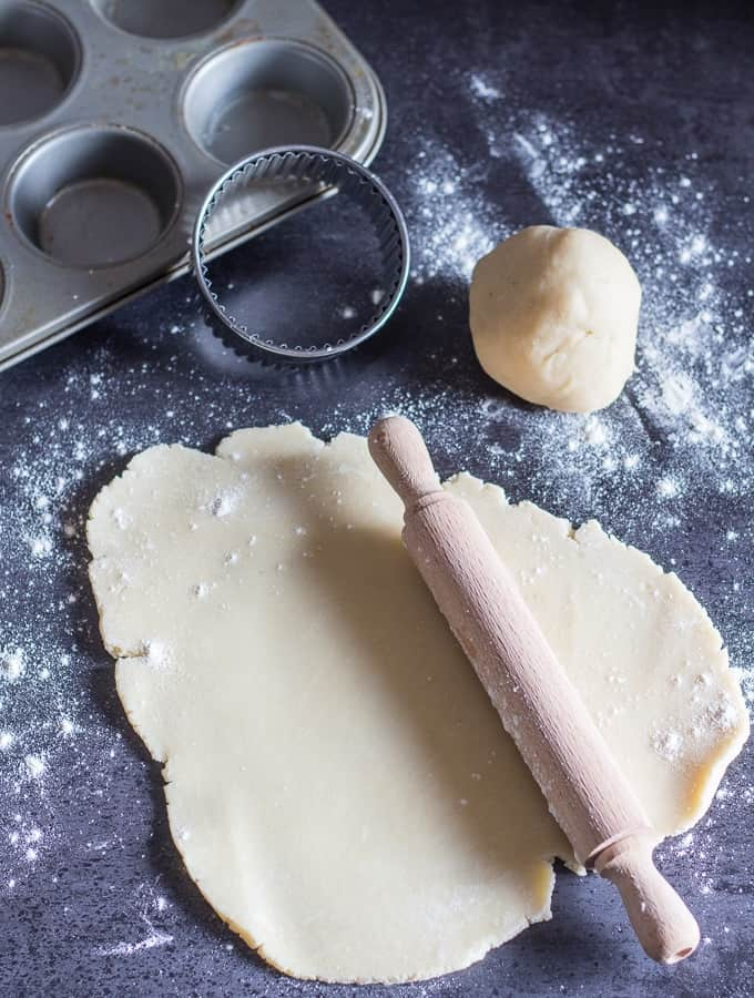rolled out easy pie dough on a black board