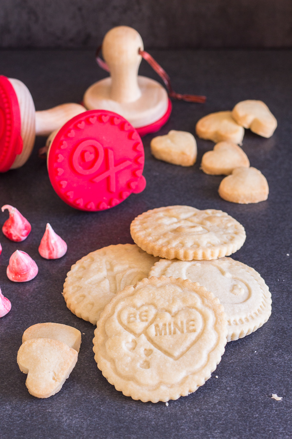 shortbread stamped cookies and cookie stamps on a black board