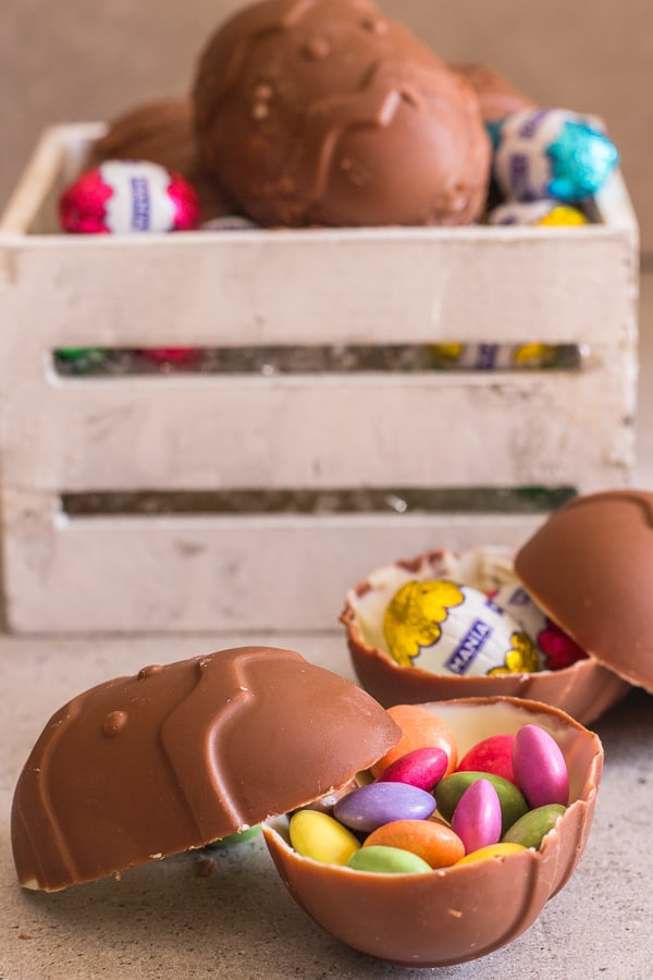 chocolate easter eggs in a box and on a board