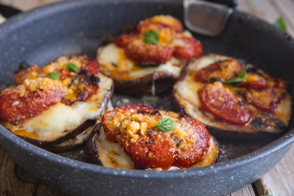 eggplant parmesan stacks in a black pan