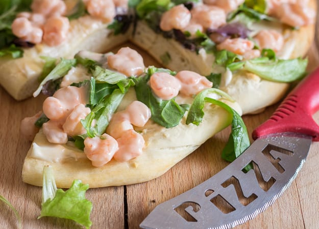 shrimp pizza with a slice cut