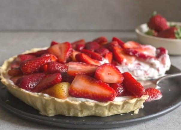 fresh strawberry pie with a cut sliced