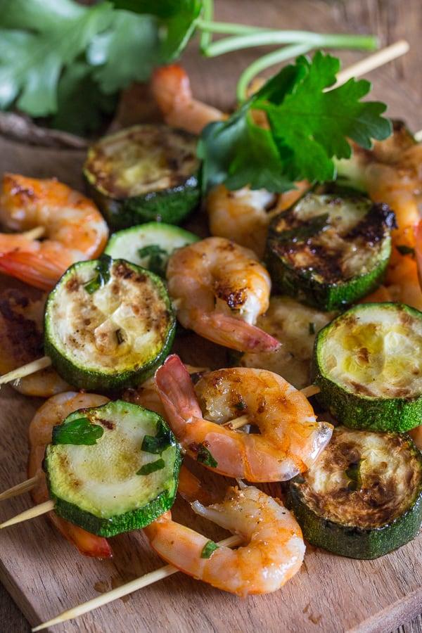 grilled shrimp skewers on a wooden board