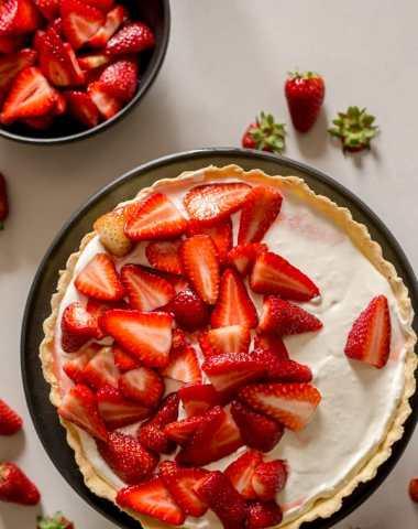 fresh strawberry pie on a white board