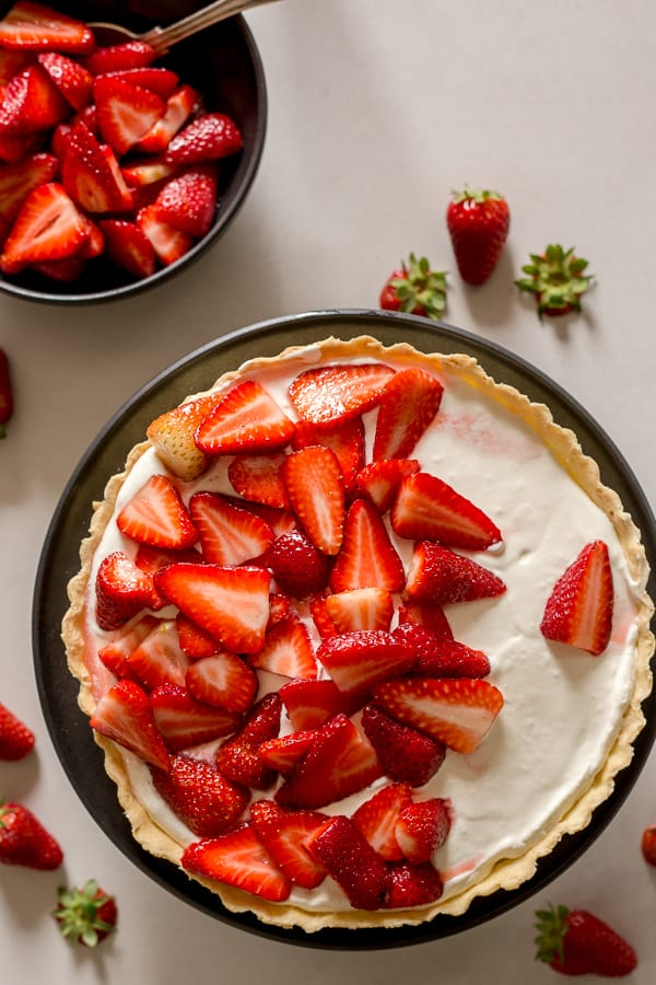 fresh strawberry pie on a white board