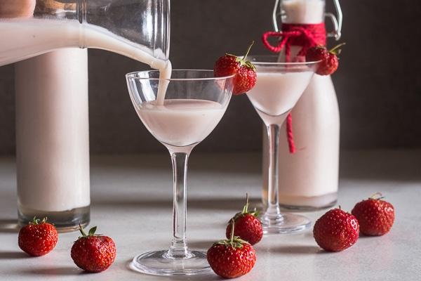 Creamy Strawberry Liqueur pouring into a glass