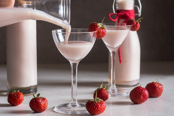 Creamy Strawberry Liqueur pouring into a glass