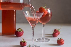 strawberry liqueur pouring into a glass