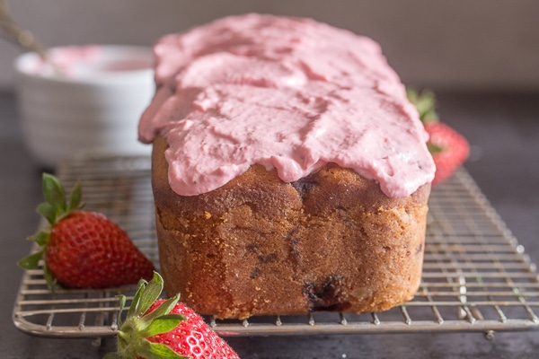 strawberry bread frosted on a wire rack