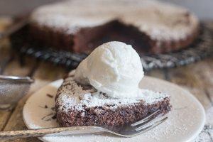 brownie cake slice on a white plate