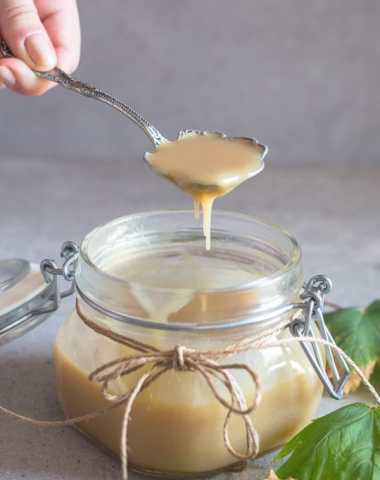 caramel sauce pouring from a spoon