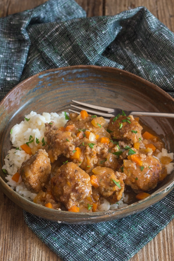 little meatballs in a brown plate with rice