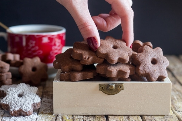 reaching for a chocolate canestrelli cookie