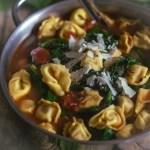 tortellini soup in a silver pot
