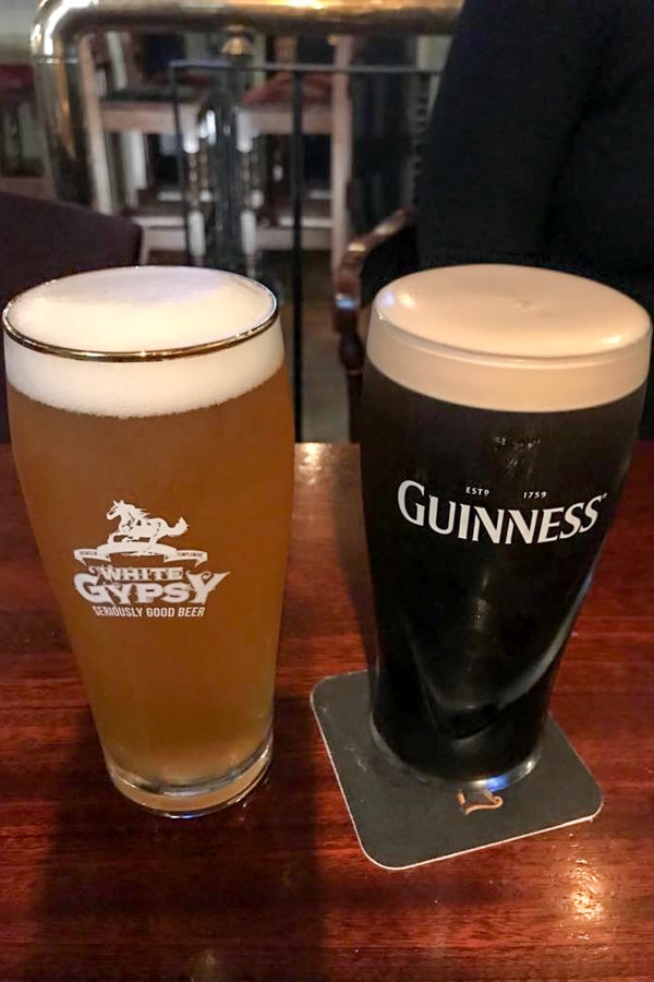 irish beer draft and guinness on a table