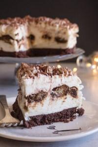 tiramisu cheesecake with a slice on a plate